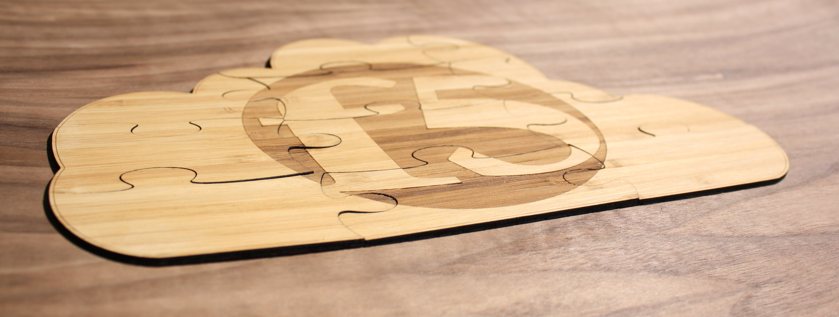 wood engraved logo puzzle in solid bamboo ply